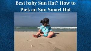 Best Baby Sun Hat? Girl on the beach wearing a cloth cover for her hair.