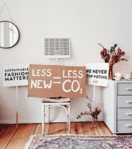 Sustainable baby fashion trends-Image of a room with singing for sustainable fashion.