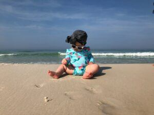Baby-Girl-At-The_Beach