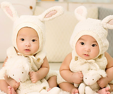 Used baby Clothes-2-Cute-Babies-Dressed-Indentical with bunny ears.