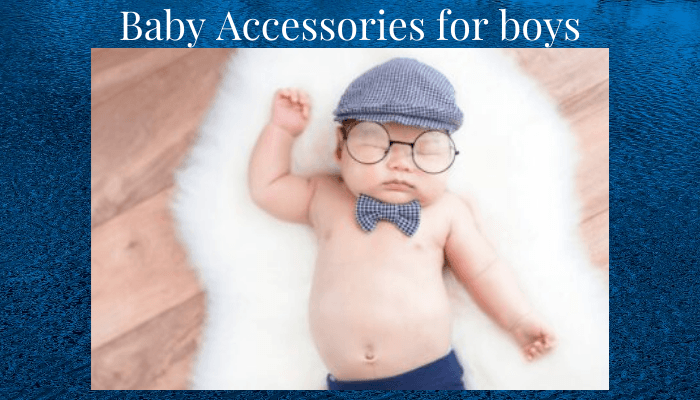 Baby accessories for boys-Baby boy laying down wearing various accessories