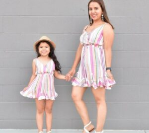 Mother and daughter matching outfits-Mother and daughter in multicolored matching outfits.