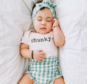 Finn Rmma Review-Sleeping baby wearing organic Chunky onesie
