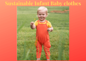Sustainable Infant Baby Clothes-baby girl in sustainable orange jumpsuit with yellow flower in hand.