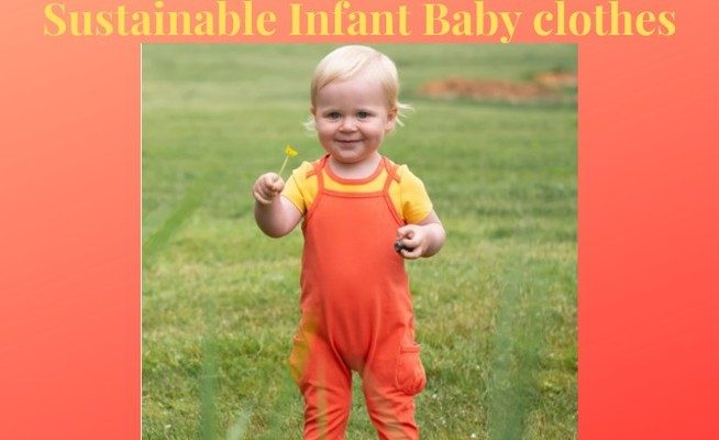 Sustainable Infant Baby Clothes-Baby in Orange Jumpsuit holding a flower