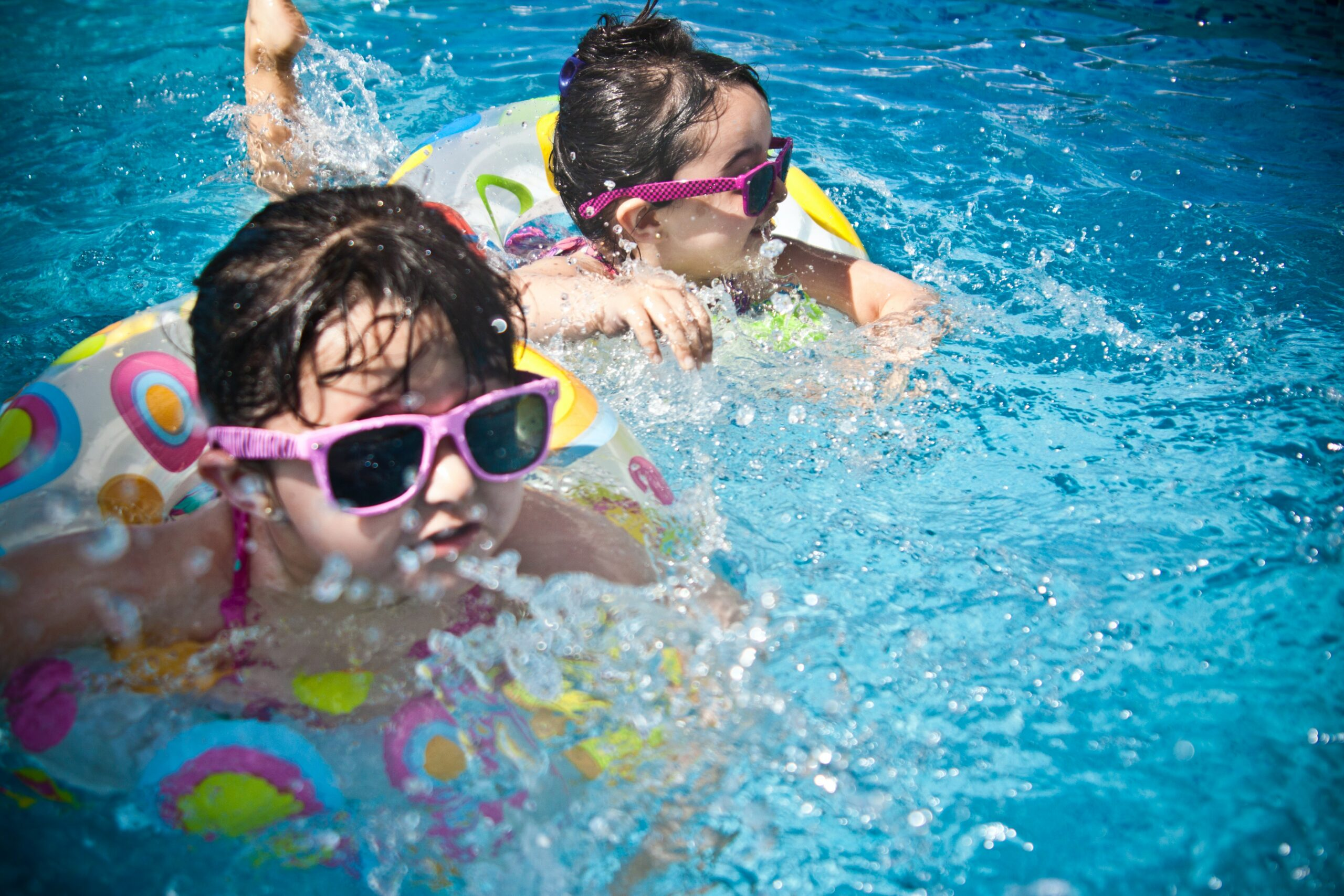 Best infant sunglasses-two girls swimming with sunglasses