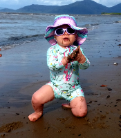 Cancer Council Sunglasses-Baby on beach wearing sunglasses