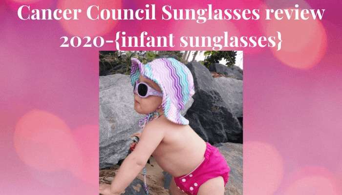 Cancer Council Sunglasses Review 2020-Baby standing by rocks wearing Cancer council Sunglasses