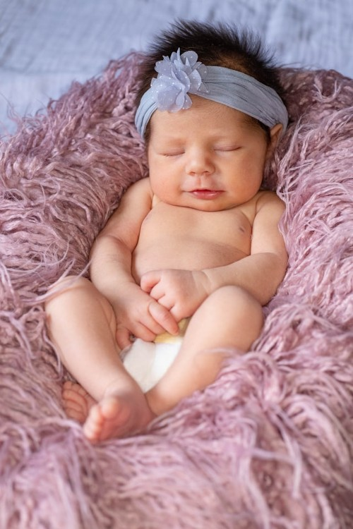 Is purchasing eco disposables as bulk nappies in Australia worth it?-Baby laying on purple rug in white nappy.