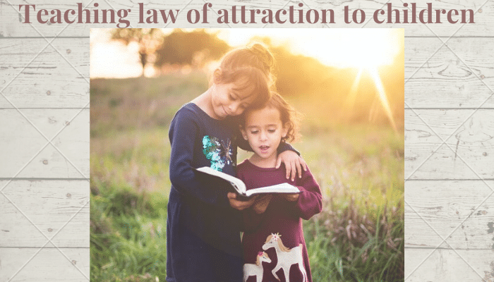 Teaching law of attraction to children-Two young girls reading happily outside in the sunshine