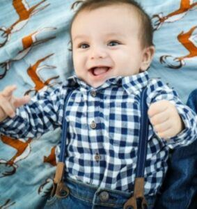 Best gender neutral baby clothes-Baby boy dressed in specific baby gender outfit
