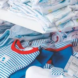 How are cheap baby clothes made?-Pile of baby clothes