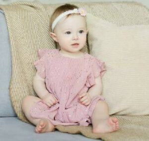 Best gender neutral baby clothes-baby girl in pink dress