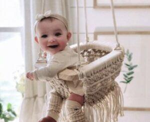 Organic Cotton baby's swings-Smiling baby swinging in organic macrame baby swing