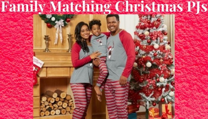Family Matching Christmas PJs-Family of 3 wearing matching Christmas PJs.