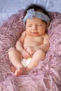 Best Eco Friendly Nappies? Baby laying down happily wearing a nappy