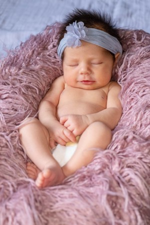 Starting out with reusable nappies-Baby at sleep wearing white nappy.
