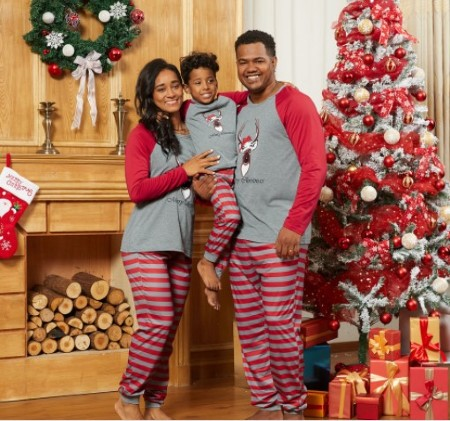 Family matching Christmas PJs- Family of 3 wearing family matching Christmas PJs