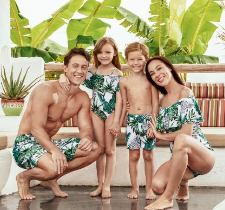 Family matching Christmas PJs-Family of 4 wearing matching swimmers