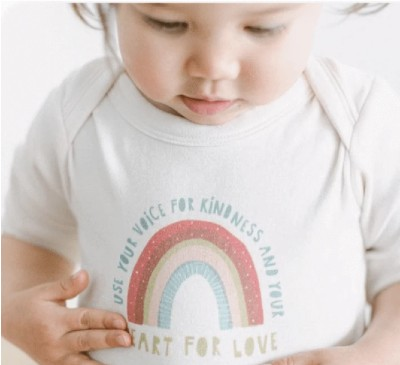 Best Organic baby clothes for a newborn-Bay wearing organic onesie stating: 'Use your voice for kindness and your heart for love'.