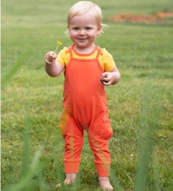 What is Oeko-Tex 10o certified mean?-Baby wearing orange Oeko-Tex 100 cetified playsuit