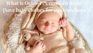 What is Oeko-Tex certified mean? Sleeping newborn baby holding a soft toy