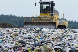 Would you consider renting baby clothes for a newborn?-Machinery working on landfill side.