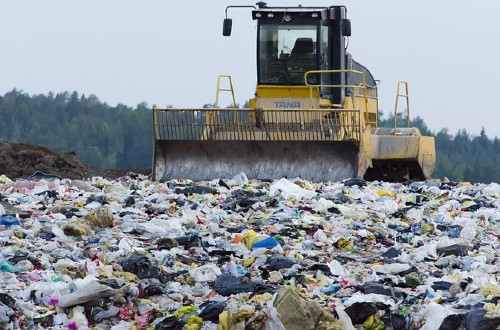 Would you consider renting the baby clothes for a newborn?-Machinery working on landfill site.