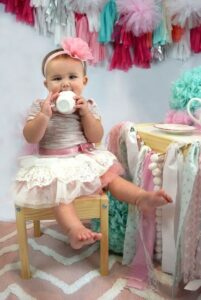 Babies first birthday clothing-Baby girl wearing special first birthday outfit and headband