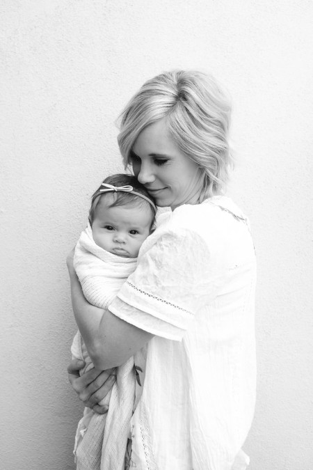 Organic baby clothes for girl's-Mother holding her precious newborn baby.