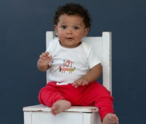 Best gender neural baby clothes-Baby wearing a organic colorful gender neutral outfit.