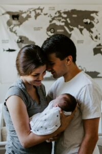 Best infant baby clothing gift sets-Parents holding their newborn baby.