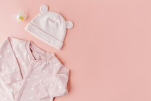 What's Simple Joys by Carter's?=Pink baby girl outfit with hat.
