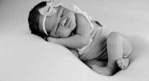 Justcutebabyclothes.com header-baby in cute outfit.