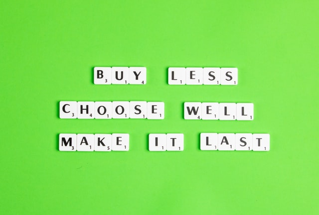 Sustainable baby clothes trends-Scrabble letters wording 'Buy Less choose well make it last.